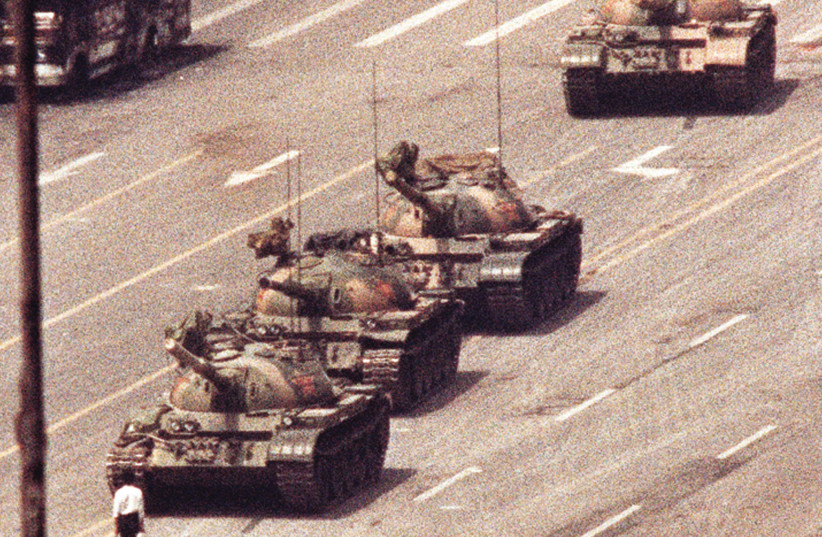 THE ICONIC PHOTO of a man standing in front of a convoy of tanks in the Avenue of Eternal Peace in Beijing, China, June 5, 1989.  (photo credit: REUTERS)