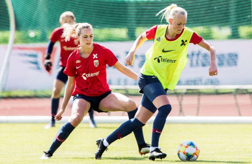 Stine Hovland and Karina Saevik in action during the training ahead of FIFA Women's World Cup in France, in Moss, Norway May 28, 2019 (photo credit: NTB SCANPIX/TERJE PEDERSEN VIA REUTERS)