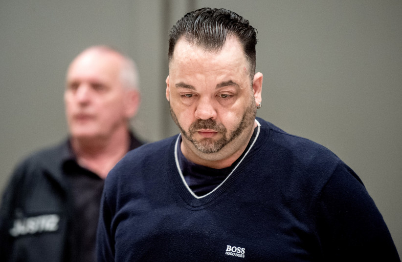 Niels Hoegel, accused of murdering 100 patients at the clinics in Delmenhorst and Oldenburg, attends his trial in Oldenburg, Germany June 6, 2019. (photo credit: HAUKE CHRISTIAN DITTRICH/ REUTERS)