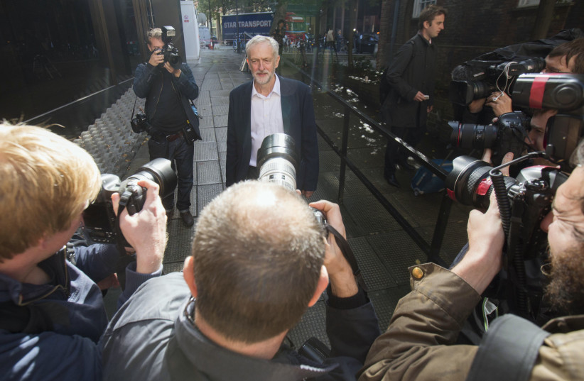 Britain's opposition Labour Party leader Jeremy Corbyn leaves his party's headquarters in London, Britain September 14, 2015 (photo credit: NEIL HALL/REUTERS)