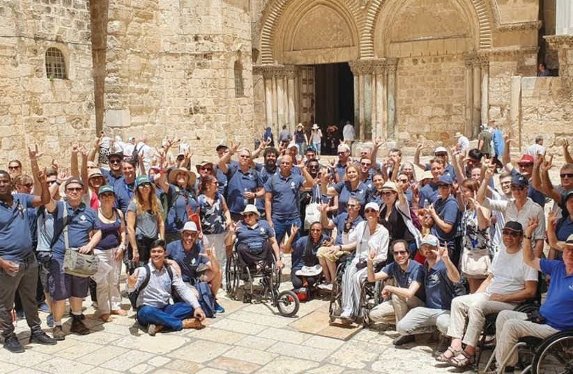 ATTENDEES OF the Access Israel 'Future of Accessibility' conference visit the Old City in Jerusalem.  (photo credit: HOWARD BLAS)
