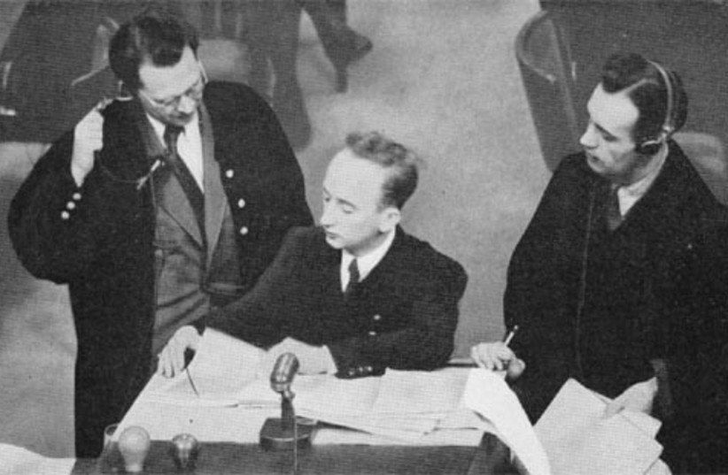 Attorneys Bergold and Aschenauer with Prosecutor Ferencz at the Einsatzgruppen Trial (photo credit: WIKIMEDIA)