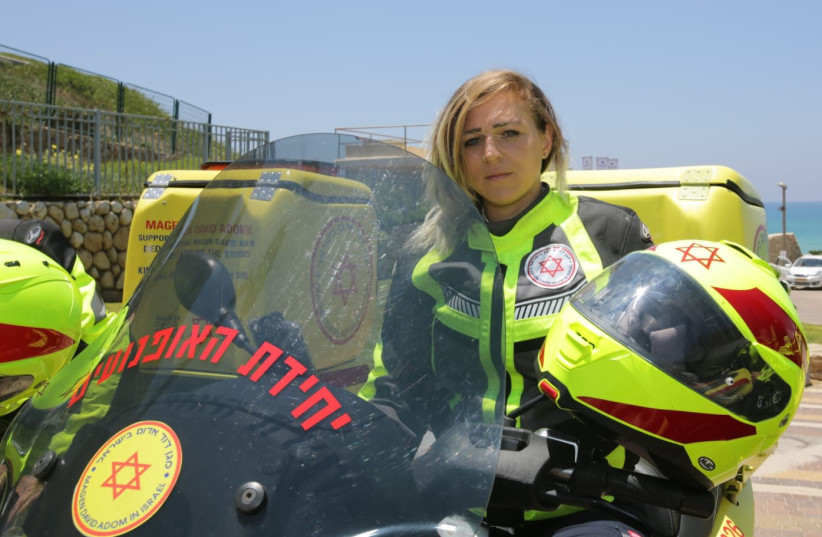 Lita Barzon,  a woman-medic who is a part of the emergency service motorcycle unit  (photo credit: MAGEN DAVID ADOM)