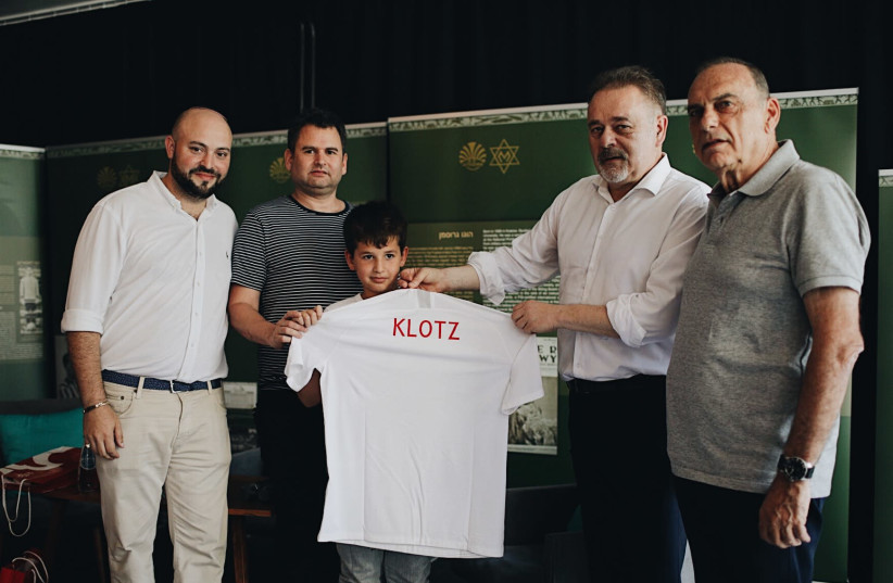 [From Left to Right] Director of From The Depths Jonny Daniels, Yoav and Eitan Dekel, Director of the the Polish Football association PZPN Janusz Basalajand  Mr. Avram Grant.  (photo credit: FROM THE DEPTHS)