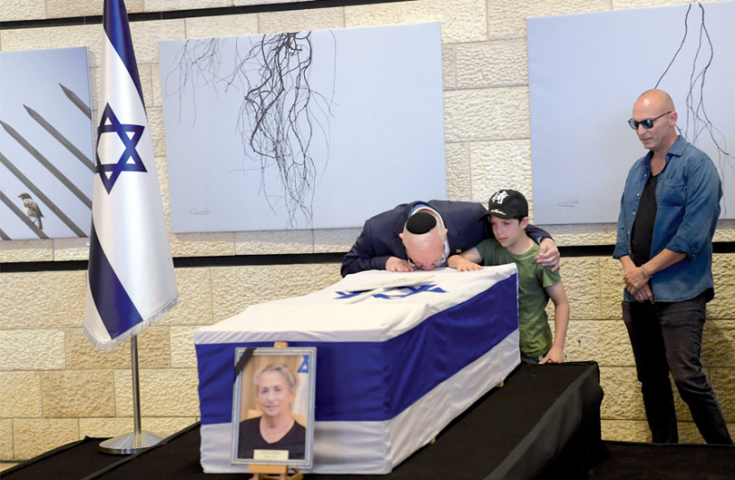 resident Reuven Rivlin kisses the coffin of his wife, Nechama, at the Jerusalem Theater on June 5, before her funeral on Mount Herzl. (photo credit: GPO/AMOS BEN GERSHOM)