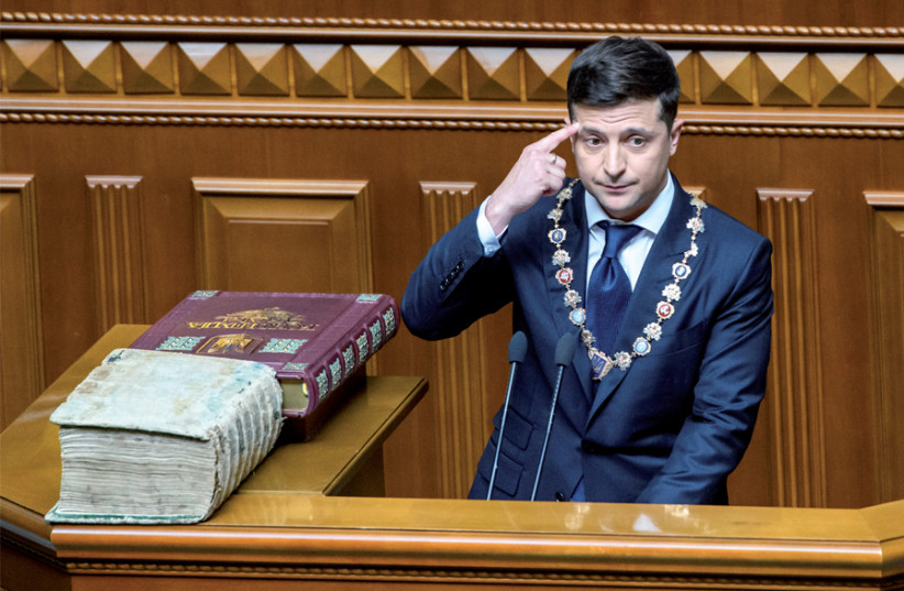 Ukraine President Volodymyr Zelensky takes the oath during his inauguration ceremony in parliament hall in Kiev on May 20 (photo credit: VLADYSLAV MUSIIENKO / UKRAINIAN GOVERNMENTAL PRESS SERVICE / REUTERS)