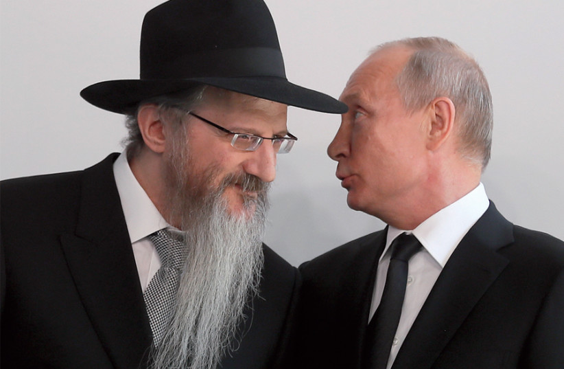 Russia's President Vladimir Putin chats with Chief Rabbi Berel Lazar during a ceremony unveiling a monument to heroes of resistance in concentration camps and ghettos during World War II, on June 4 (photo credit: SERGEI ILNITSKY / REUTERS)