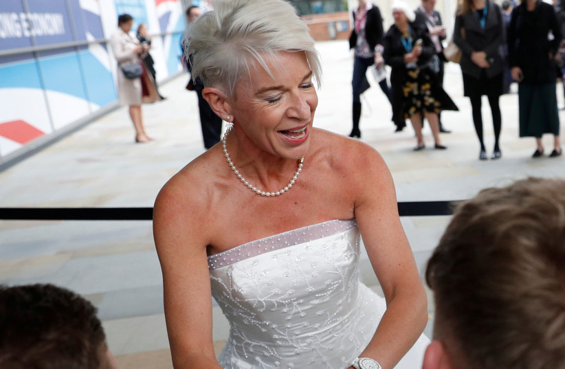 Newspaper columnist Katie Hopkins arrives dressed in a wedding dress at the Conservative Party's conference in Manchester, Britain October 2, 2017 (photo credit: PHIL NOBLE/REUTERS)