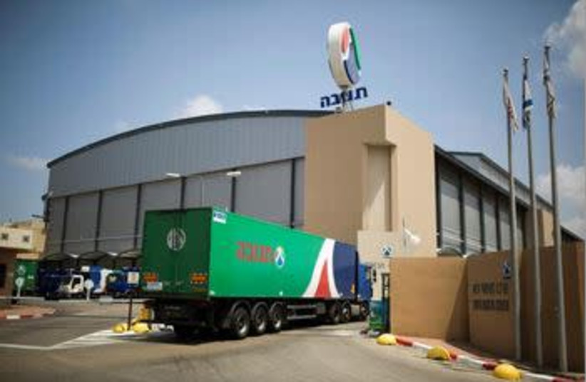A Tnuva truck enters the company's logistic centre in the southern town of Kiryat Malachi, Israel May 22, 2014.  (photo credit: REUTERS/AMIR COHEN/FILE PHOTO)