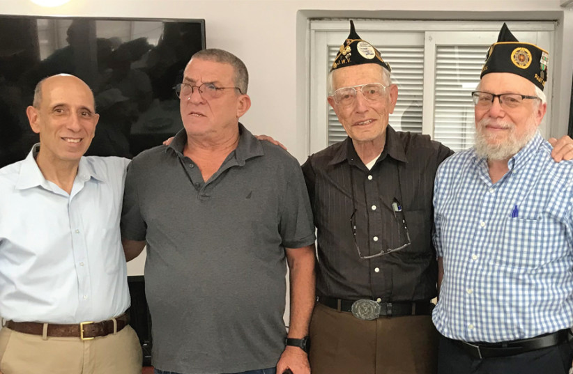 (LEFT TO right) Post Events chairman Gershon Katz, Yom Kippur War veteran Uri Ehrenfeld, Post commander Avraham Kriss and US veteran Aryeh Wetherhorn at the Jewish War Veterans of the USA's Jerusalem branch general meeting on May 30. (photo credit: ROSSELLA TERCATIN)