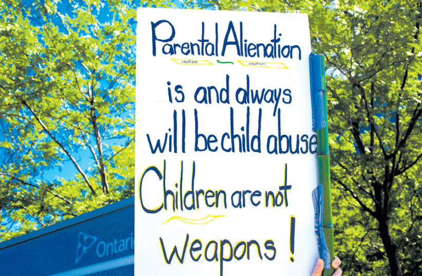 AT A family court protest in Ontario. (photo credit: EVAN DELSHAW/FLICKR)