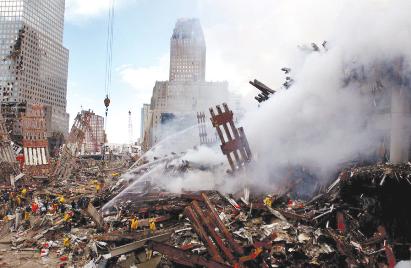 FIRES STILL burn amid the rubble and debris of New York City's World Trade Center on September 13, 2001, two days after the 9/11 terrorist attacks. (photo credit: Wikimedia Commons)