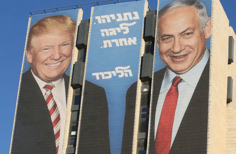 A LIKUD CAMPAIGN poster in Jerusalem featuring the Trump- Netanyahu bond. (photo credit: MARC ISRAEL SELLEM)