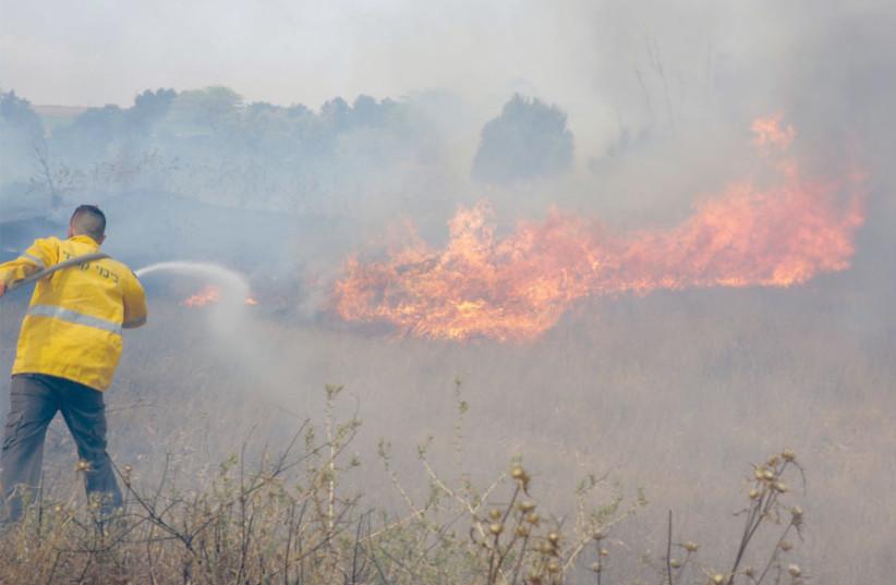 FIGHTING A fire in a blazing field. (photo credit: YEHUDA PERETZ/KKL-JNF PHOTO ARCHIVE)