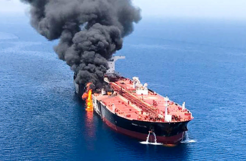 An oil tanker is seen after it was attacked at the Gulf of Oman, June 13, 2019 (photo credit: ISNA/REUTERS)