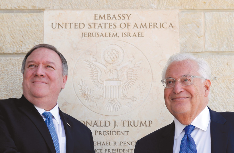 US SECRETARY OF State Mike Pompeo and US Ambassador to Israel David Friedman stand next to the dedication plaque at the US Embassy in Jerusalem in March (photo credit: JIM YOUNG/REUTERS)