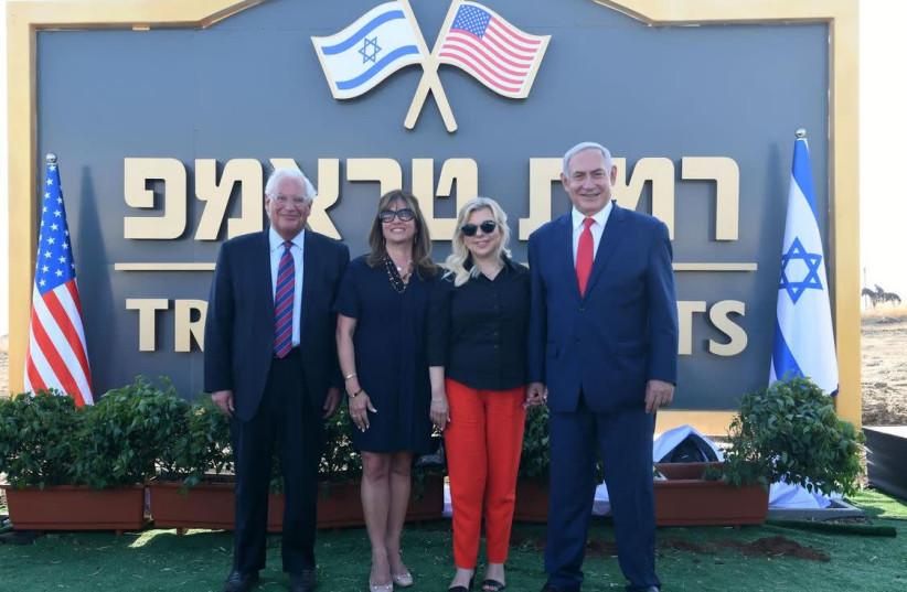 US Ambassador to Israel David Friedman [L] his wife Tammy Deborah Sand, Sara Netanyahu, and Prime Minister Benjamin Netanyahu [R] near the sign of Trump Heights in the Golan  (photo credit: KOBI GIDON / GPO)