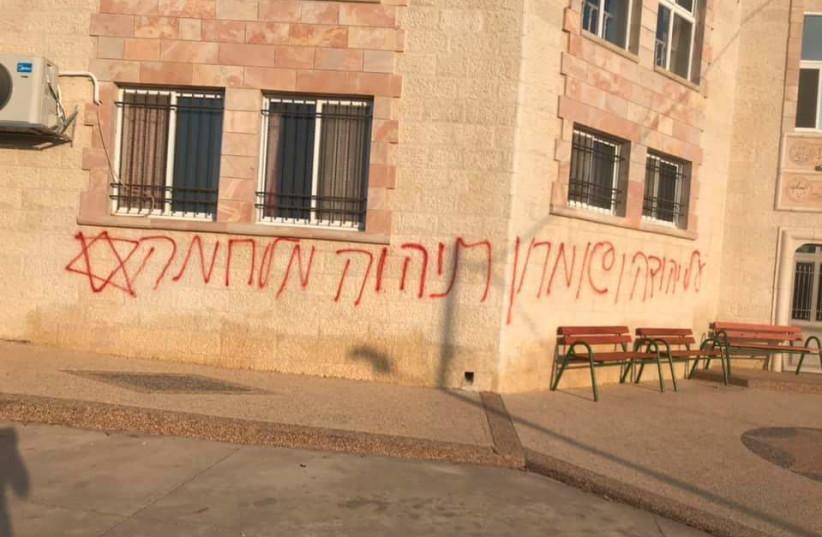 Graffiti in Hebrew sprayed in Deir Istiya, 'over Judea and Samaria there will be a war.'  (photo credit: VILLAGE COUNCIL OF DEIR ISTIYA)