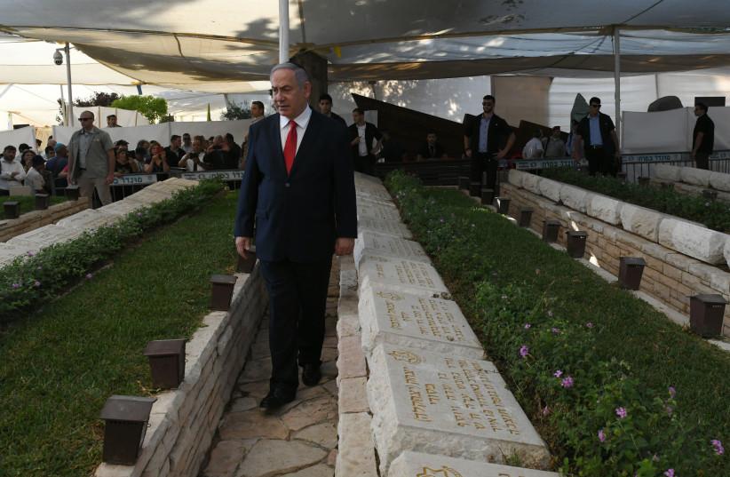 Benjamin Netanyahu at a memorial service (photo credit: GPO)