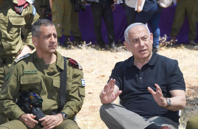 Prime Minister Benjamin Netanyahu and IDF Chief of Staff Lt.-Gen. Aviv Kochavi (photo credit: AMOS BEN-GERSHOM/GPO)