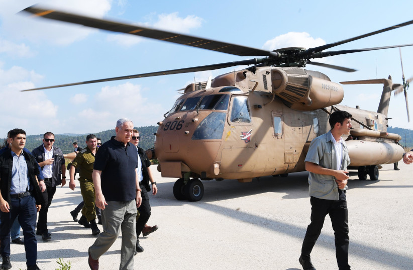 Prime Minister Benjamin Netanyahu at an army exercise in the north on June 19th, 2019 (photo credit: AMOS BEN-GERSHOM/GPO)