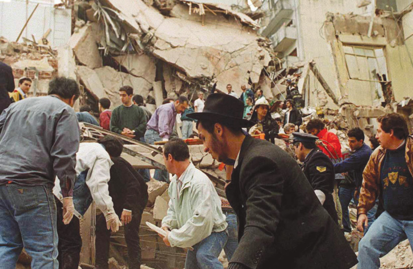 RESCUE WORKERS search for survivors and victims in the rubble left after a powerful car bomb destroyed the Buenos Aires headquarters of the Argentine Israeli Mutual Association (AMIA), in this July 18, 1994 photo (photo credit: REUTERS)