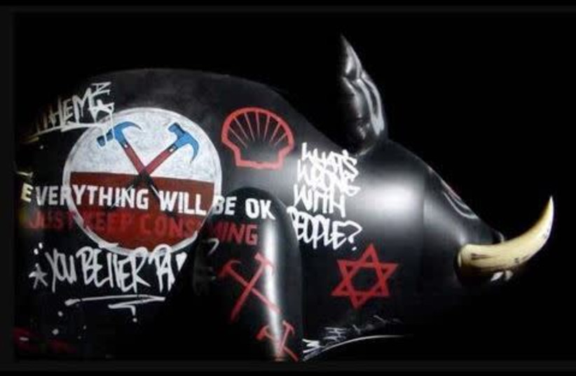 An inflatable pig with a Star of David painted on it was displayed during a Roger Waters performance of The Wall in Belgium in 2013 (photo credit: Courtesy)