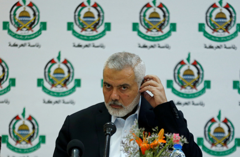 Hamas Chief Ismail Haniyeh attends a meeting with members of international media at his office in Gaza City, June 20, 2019 (photo credit: MOHAMMED SALEM/ REUTERS)