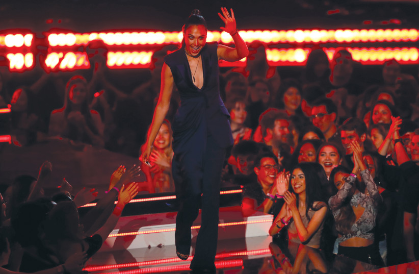 GAL GADOT waves to fans at the MTV Movie and TV Awards in Santa Monica, California, last week. Do any of them care that she's Israeli? (photo credit: MIKE BLAKE/ REUTERS)