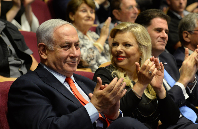 Prime Minister Benjamin Netanyahu and his wife, Sara Netanyahu, at the Jerusalem Theater (photo credit: CHAIM TZACH/GPO)