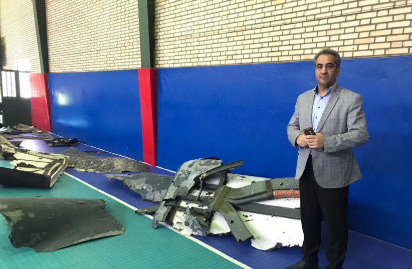 Pieces of the American drone that were shot down by Iran in the Straits of Hormuz (photo credit: Courtesy)