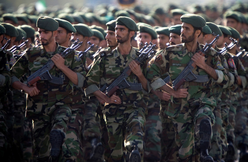 Members of Iran's Revolutionary Guards march during a military parade to commemorate the 1980-88 Iran-Iraq war in Tehran (photo credit: MORTEZA NIKOUBAZI/ REUTERS)
