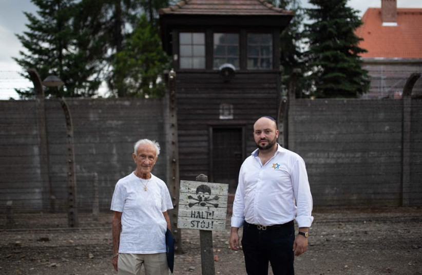 Holocaust survivor Edward Mosberg and From the Depths founder Jonny Daniels stand outside Auschwitz Concentration Camp. (photo credit: FROM THE DEPTHS)