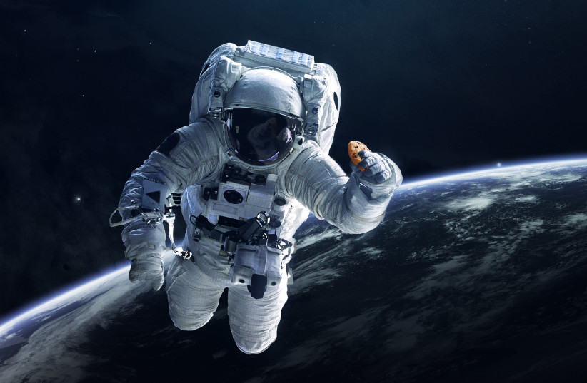 An illustration of an astronaut with a DoubleTree by Hilton Cookie (photo credit: BUSINESS WIRE)