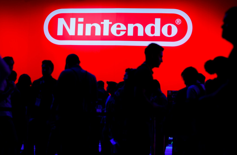 A display for the gaming company Nintendo is shown during opening day of E3, the annual video games expo revealing the latest in gaming software and hardware in Los Angeles (photo credit: MIKE BLAKE/ REUTERS)