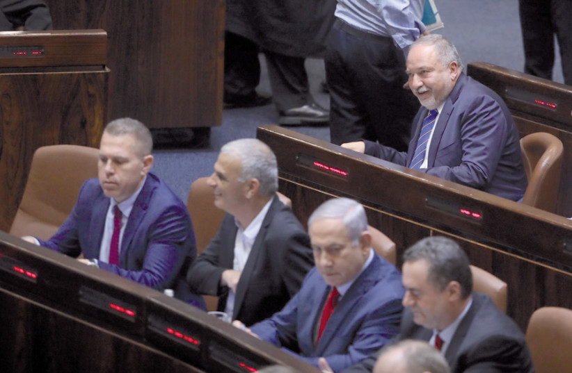 Avigdor Liberman sits behind Prime Minister Benjamin Netanyahu on May 29, when the Knesset decided to call new elections on September 17 (photo credit: MARC ISRAEL SELLEM)