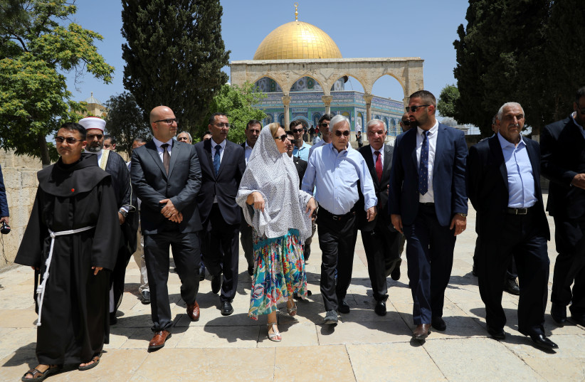 The Dome of the Rock is seen in the background as Chilean President Sebastian Pinera and his wife Cecilia Morel walk on the compound known to Muslims as Noble Sanctuary and to Jews as Temple Mount, during their visit to Jerusalem's Old City June 25, 2019 (photo credit: REUTERS/AMMAR AWAD)
