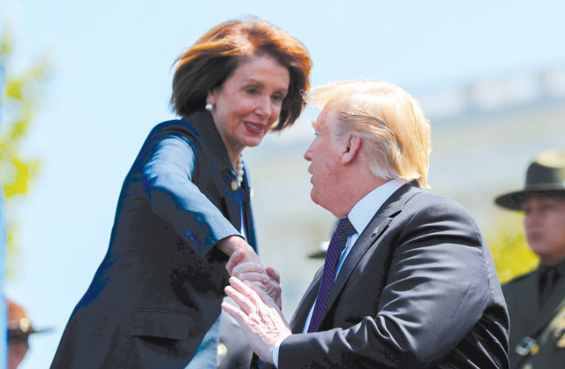 US PRESIDENT Donald Trump and Speaker of the House Nancy Pelosi attend the annual National Peace Officers Memorial Service, on Capitol Hill in Washington on May 15. (photo credit: REUTERS/CARLOS BARRIA)