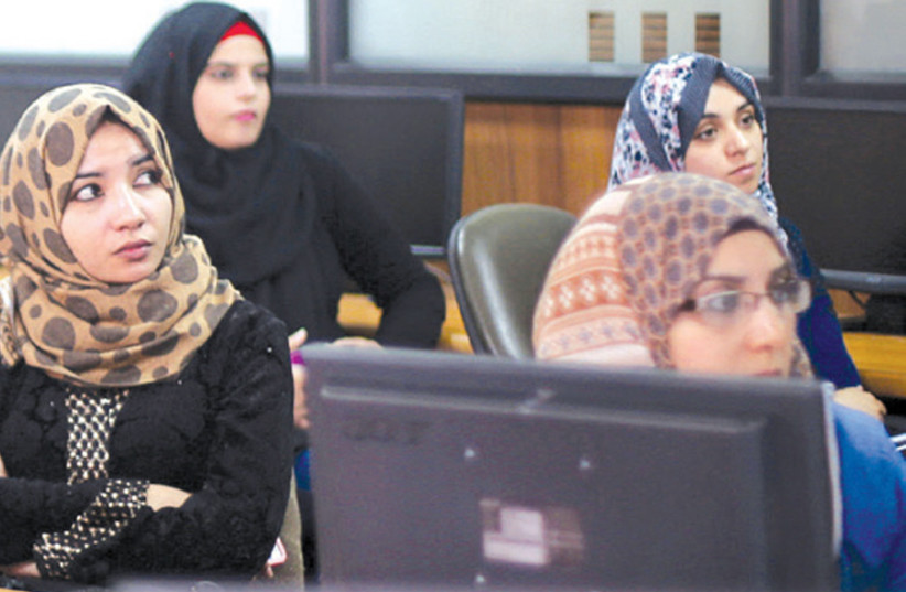 PALESTINIAN ENTREPRENEURS attend a training session in the UCAS Technology Incubator office in Gaza. (photo credit: IBRAHEEM ABU MUSTAFA / REUTERS)
