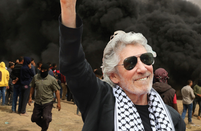 Roger Waters, draped with a Palestinian keffiyeh (photo credit: REUTERS)
