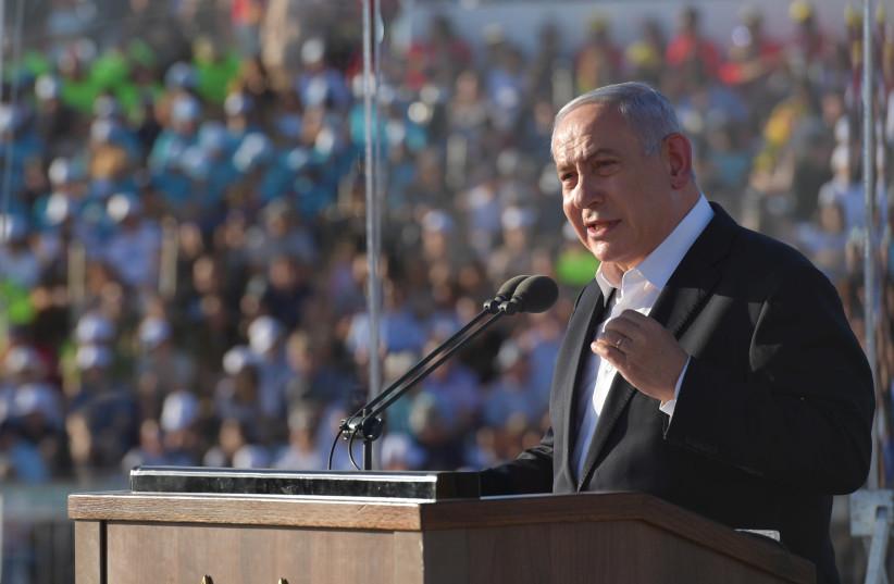 Prime Minister Benjamin Netanyahu speaks during the graduation ceremony of the Israeli Air Force's newest pilots, June 2019 (photo credit: KOBI GIDEON/GPO)