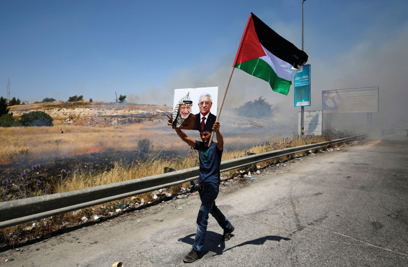 A PALESTINIAN PROTESTS the Bahrain summit (photo credit: REUTERS)
