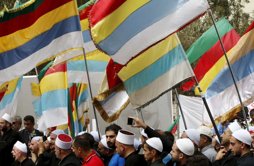 Druze Sheikhs and supporters carry Druze flags in Beirut, Lebanon, September 2015 (photo credit: MOHAMED AZAKIR / REUTERS)