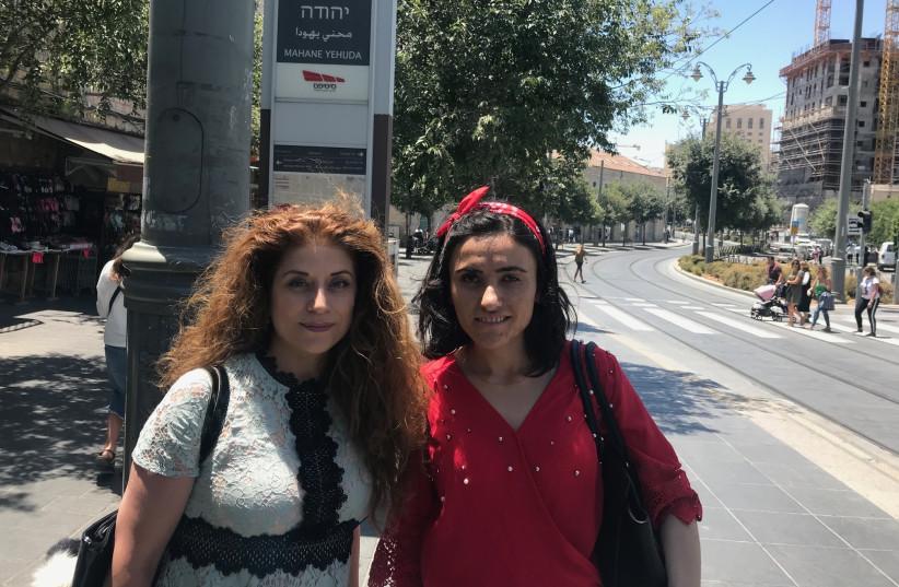 Genocide researcher  Frishta Kewe and survivor Lamya Aji Bashar Taha in Jerusalem last week (photo credit: SETH J. FRANTZMAN)