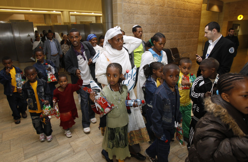 Jewish immigrants from Ethiopia arrive at Ben Gurion International Airport near Tel Aviv in 2011 (photo credit: REUTERS)