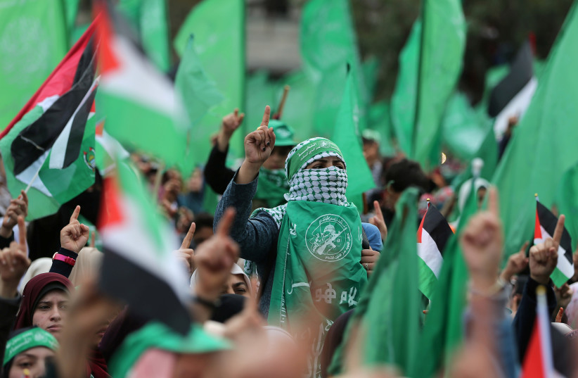 Palestinians take part in a rally marking the 31st anniversary of Hamas' founding, in Gaza City (photo credit: IBRAHEEM ABU MUSTAFA / REUTERS)