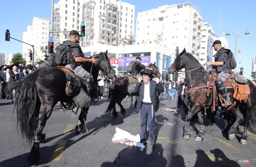 Haredi youth protest draft bill near Jerusalem entrance (photo credit: MARC ISRAEL SELLEM)