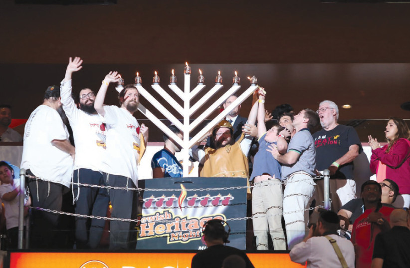 JOYOUS HANUKKAH: Lighting the menorah at Miami's Rok Family Shul – Chabad Downtown Jewish Center. (photo credit: ROK FAMILY SHUL)