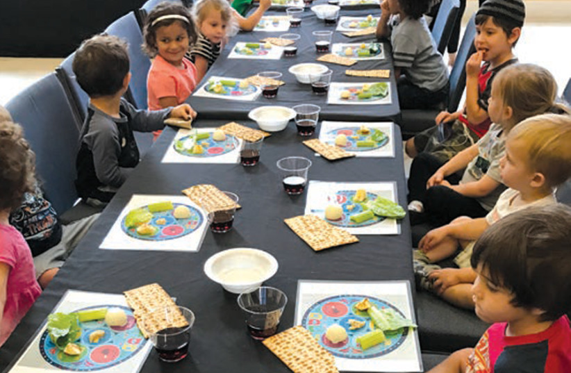 CHILDREN TAKE part in a Passover Seder. (photo credit: ROK FAMILY SHUL)