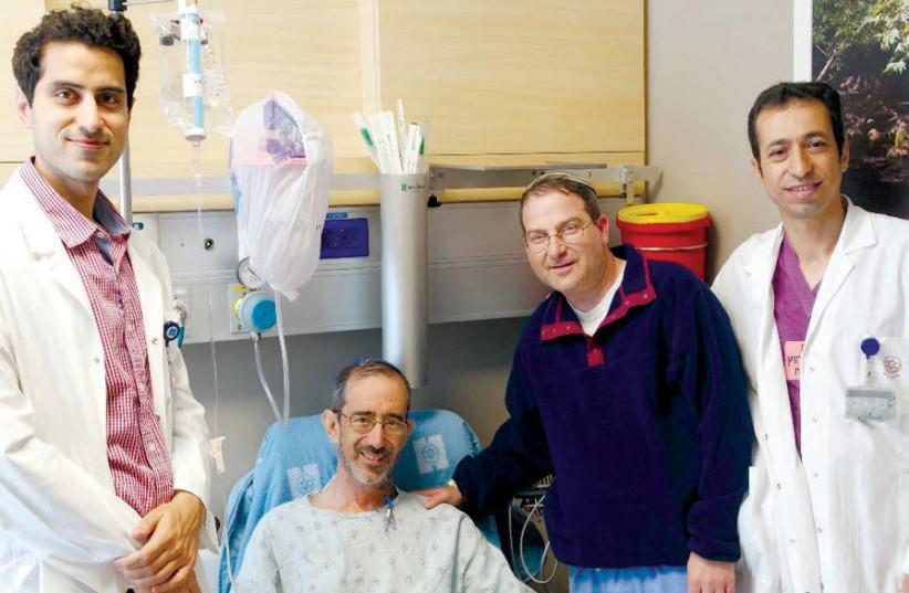 (LEFT TO right) Dr. Samir Abu- Gazala; recipient Miles Hartog (in bed); donor Dr. Moshe Halberstam; and Dr Abed Khalaila. (photo credit: HADASSAH MEDICAL ORGANIZATION)